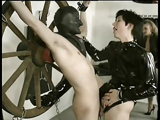 Domme taunts tied man with her cunt