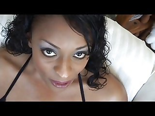 Ebony girl with big tits fingers her pussy