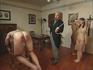 Headmaster canes two naked girls
