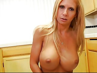gorgeous milf plays with a dildo-riding machine
