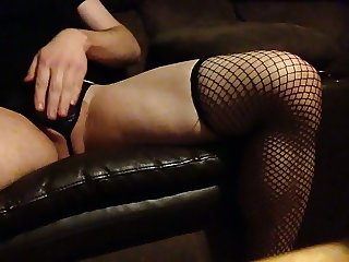 Fishnets, garter, and thong cumming.