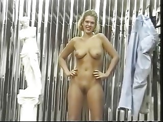 Sexy blonde chick strips to reveal her great tits and hairy pussy
