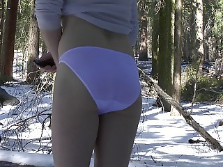 White bikini panties in the forest