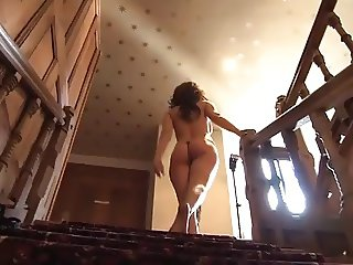 Beautiful brunette lady gets naked