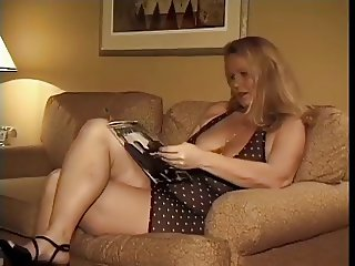 Blonde MILF takes on couch