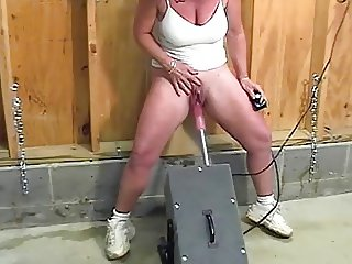 Mature with huge clit squirts while fucked by the machine