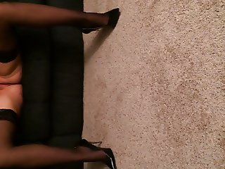 Sexy female MILF fingering herself in heels and thigh highs