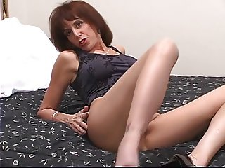 Horny mature in heels strips then stuffs playthings in her succulent pink pussy