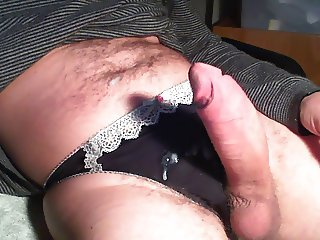 Black silk thong with spunk on them