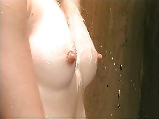 Blonde with tiny tits plays with her pussy in the shower