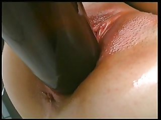 Bitch shoves bottles and dildos in pussy solo