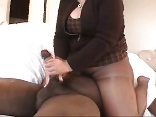 Ebony Milf in Pantyhose giving a Handjob