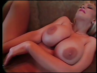 Busty blond toys  with her clit