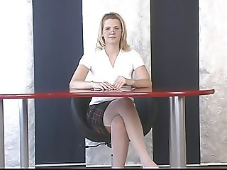 Blond showing us what girls really do underneath that desk