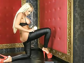 Lucy Summers in shiny spandex and red heels on BS