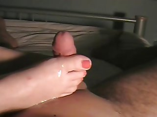 wonderful footjob with red nails and cumshot laod