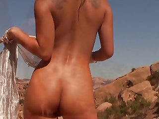 Naked Pinay beauty's bronze skin glows in the desert sun