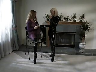 Latex-clad lesbians in action