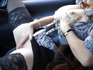 SLUTTY MILF PLAYS WITH MEN IN HER CAR