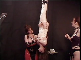 Bound brunette has her tits licked and abused