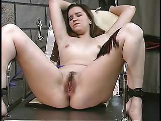 Blindfolded, gagged and shackled bdsm brunette gets vibrator held to her clit