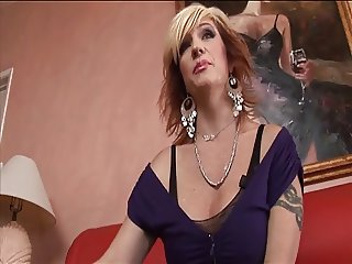 Randy MILF sucks black cock and gets her face creamed after fucking on the sofa