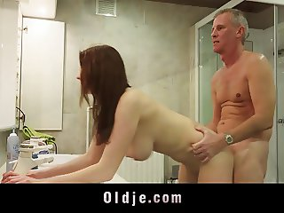 Sensous busty young girl takes old dick in the bath