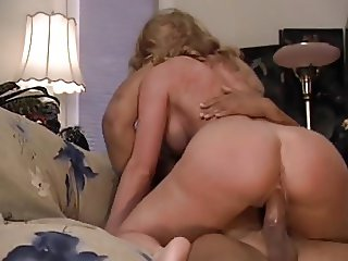 MILF with big tits sucks and fucks on the couch