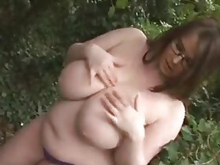 Busty Gina G Strips In The Forest