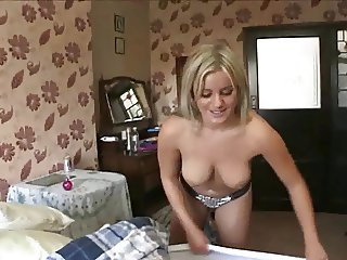 Amy makes the bed with her boobs out