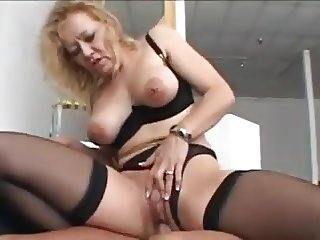 Nice blonde granny in stockings fucks a younger man