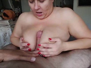 Mature BBW gives a titfuck