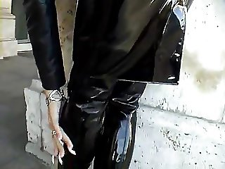 Sexy blonde lady black wet-look-outfit