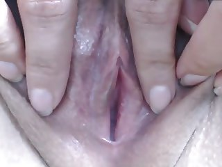 Close up tight shaved pussy clit