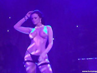 Busty MILF shows her amazing body on the stage