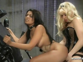 Pretty slave girl gets fucked hard by Lesbian Mistress with strap on