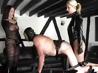 Two Mistresses fucking their slave's face, and ass