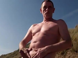 bold exhibitionist dick on the beach