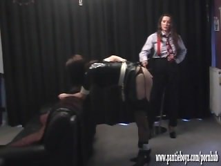 Mistress gives sexy latex tranny maid a good ass spanking and boob sucking