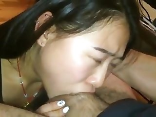 cute asian deepthroats cock