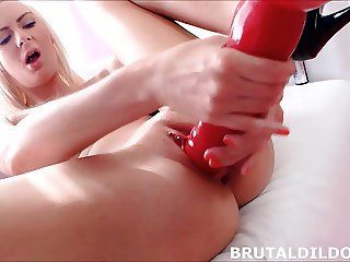 Big dildo makes her squirt