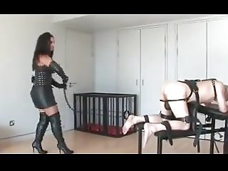 Mistress takes slave out of cage to punish him