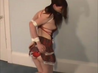 Tied up girl bound wearing sexy costume