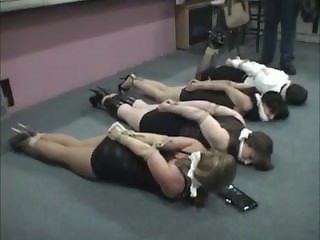 4 women bound on floor