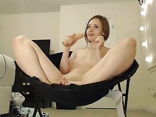 Teen showing her tiny feet while fingering with buttplug