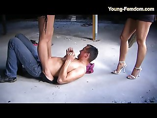 2 Young Femdom Girls in Heels and Pants dominate man in ruin