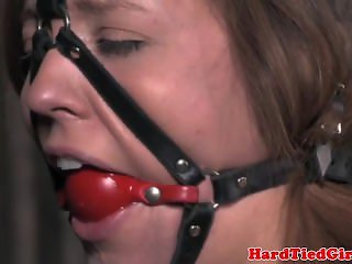 Bonded submissive slut handles nipple clamps