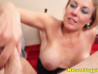 Mature milf gets cum in eye and on tits after hj