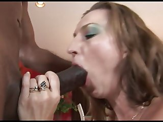 Mature bitch shows her cock sucking skills to black stud