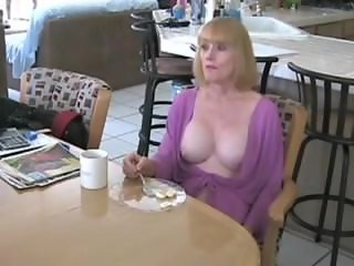 He fucks a mature mom in kitchen